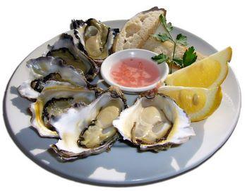 Ostriche crude con limone e scalogno marinato