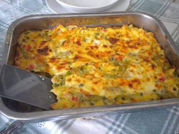 Tagliatelle di spinaci con besciamella gratinate