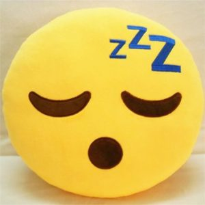 Cuscino tondo giallo con emoticon dormiente